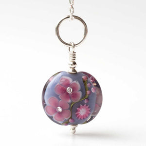 Grey floral lampwork art glass bead with cubic zirconia suspended