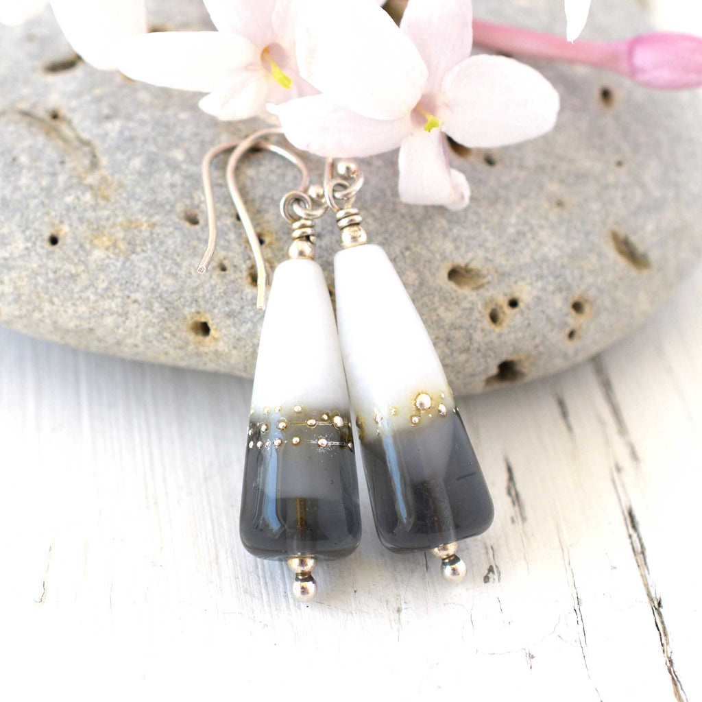 grey and white artisan glass earrings hanging