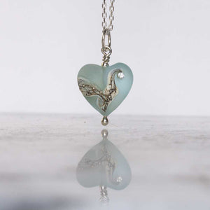 aqua blue lampwork glass heart pendant by Judith Johnston