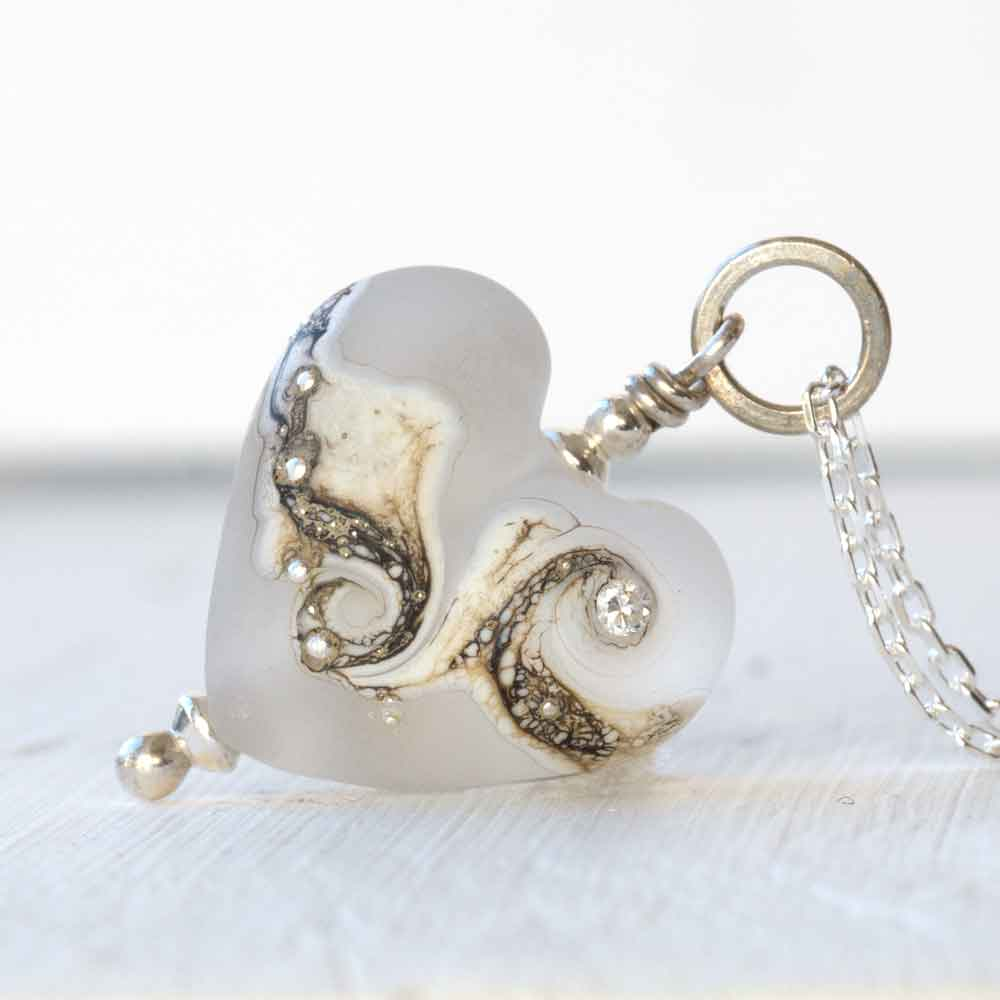 white glass heart pendant