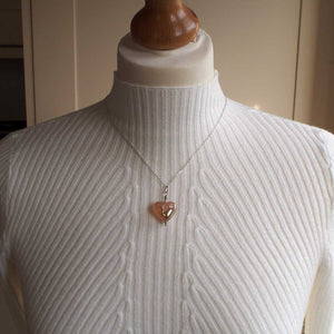 pink heart necklace on mannequin for size