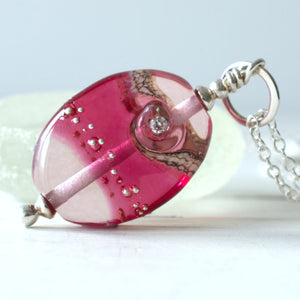 pink ruby shiny lampwork glass pendant with cubic zirconia