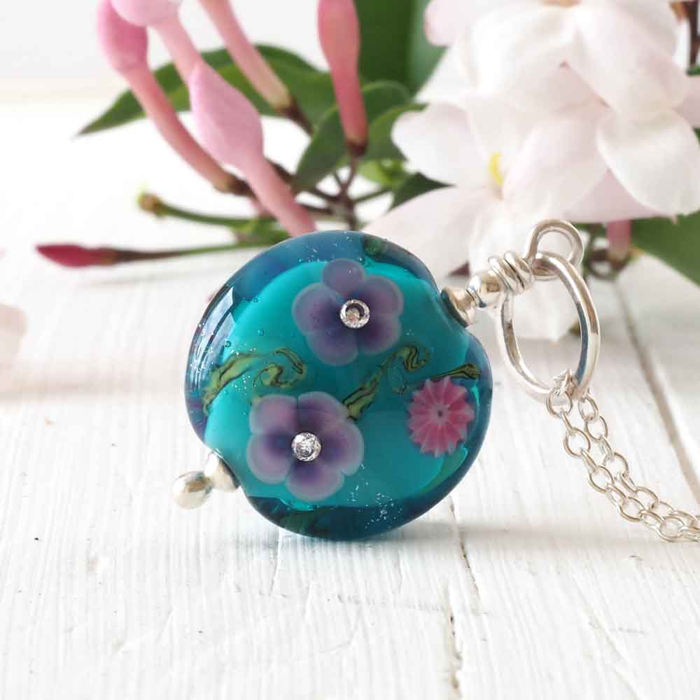 teal floral glass pendant