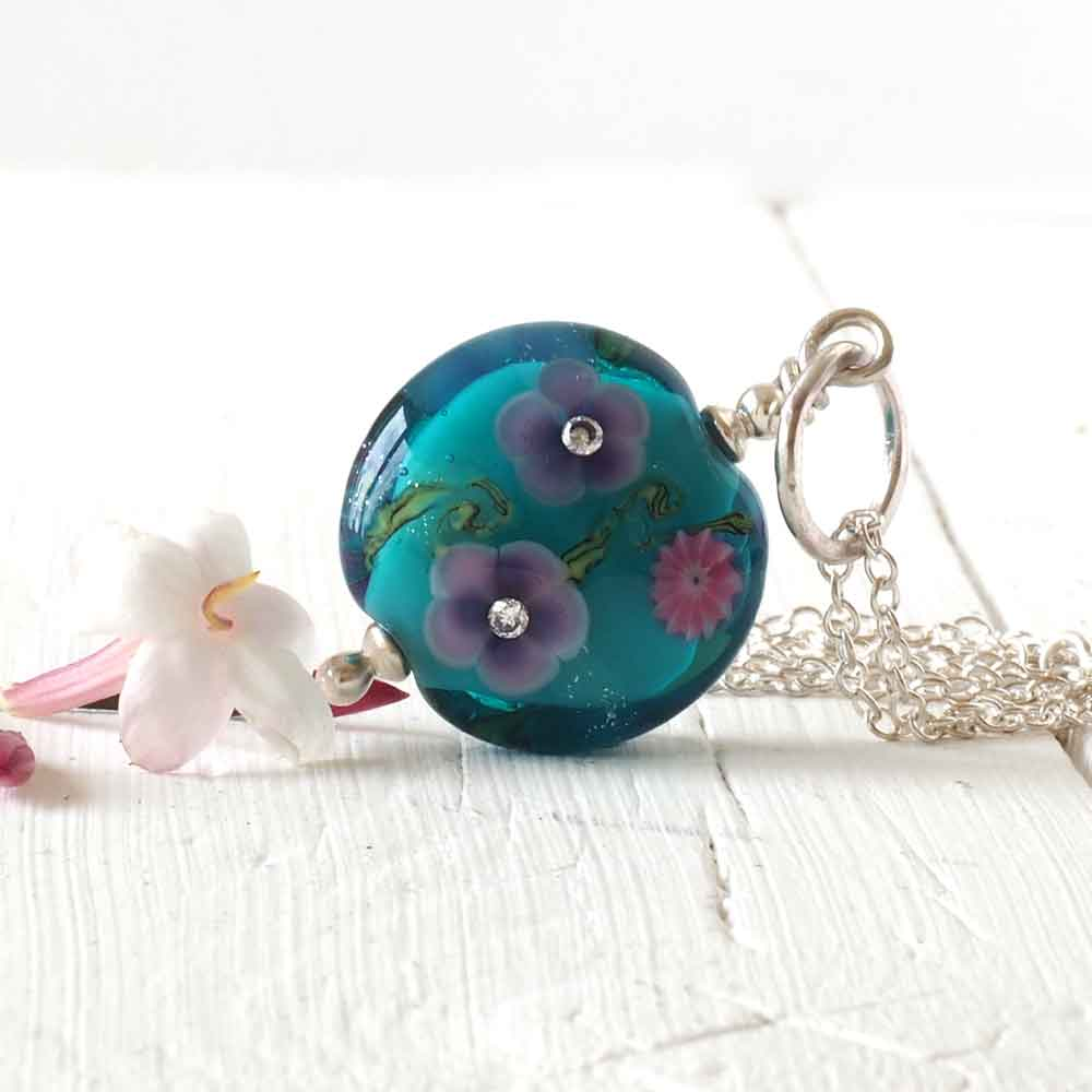 teal floral glass pendant back