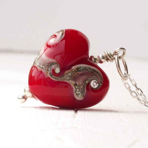 Red lampwork glass heart necklace by Judith Johnston