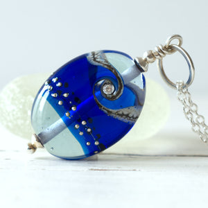 royal blue shiny lampwork glass pendant with cubic zirconia
