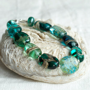 Teal green art glass bead bracelet