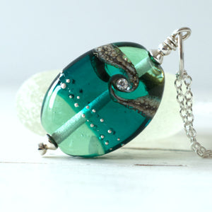 teal green shiny lampwork glass pendant with cubic zirconia