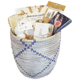 Our country house basket is the perfect gift for so many occasions from birthday to housewarming to thank you and to corporate gift. All of the items inside are especially chosen for the discerning homeowner or that special someone that just seems to be hard to buy for. It is personal while also appropriate for the corporate gift or real estate gift. We just love all of it from the basket itself to the candle, napkins, book, trivet, decorative buds, placemats and flatware holder. We just love this basket.