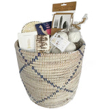 Our country house basket is the perfect gift for so many occasions from birthday to housewarming to thank you and to corporate gift. All of the items inside are especially chosen for the discerning homeowner or that special someone that just seems to be hard to buy for. It is personal while also appropriate for the corporate gift or real estate gift. We just love all of it from the basket itself to the candle, napkins, trivet, decorative buds, and flatware holder. We just love this basket.