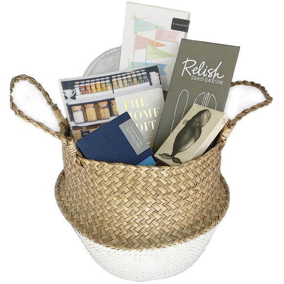 Our hooray basket is easily versatile for a multitude of occasions. It is a great wedding gift, house warming, birthday gift or corporate or real estate gift to a customer. All of the items inside our fantastic belly basket made in Vietnam circle around the home. A great home organization book, a platter, candle and serving tools, which are the essential items all of us need!