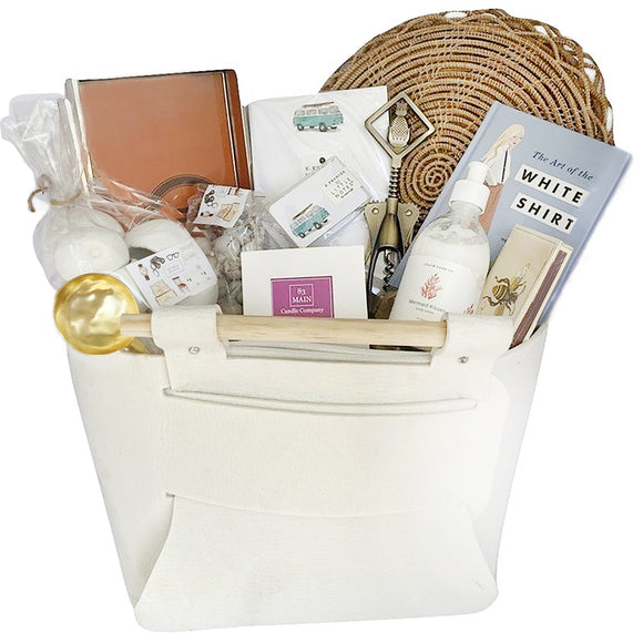 We all have that friend, sibling or colleague that has it all. Well, this is the gift for them. This solves all of your shopping dilemmas all housed in a beautiful felt handled basket. Everything in here form the candle to the book to the decorative bell cups and more are perfect for that person who just has it all!