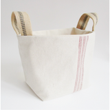 This large bucket tote with French ticking and jute webbing handles carries all of the contents of our beautiful holiday basket. When all of the goodies are taken out and enjoyed, this bucket tote is the perfect catchall for anything from toilet paper, to mail to yarn or anything in between.