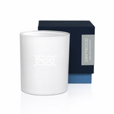 "Luxury soy wax candle in a modern white candle glass container. Has a clean, minimal white on white knot graphic   - Hand-poured, small batch   - Packaged in a navy textured paper gift box   - 7 oz  Driftwood fragrance notes: Amber, cedar and sandalwood.  ""Like a bundled up beach walk on the hunt for rocks, driftwood and peace of mind."""
