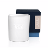 "Luxury soy wax candle in a modern white candle glass container. Has a clean, minimal white on white knot graphic   - Hand-poured, small batch   - Packaged in a navy textured paper high-end gift box   - 7 oz  Dune fragrance notes: Shimmering citrus, water lily and sea grass  ""Cooler air, smaller crowds and the serene scent of shimmering citrus, water lily and sea grass. Grab a sweater, pick a sand dune and watch the waves roll in."""