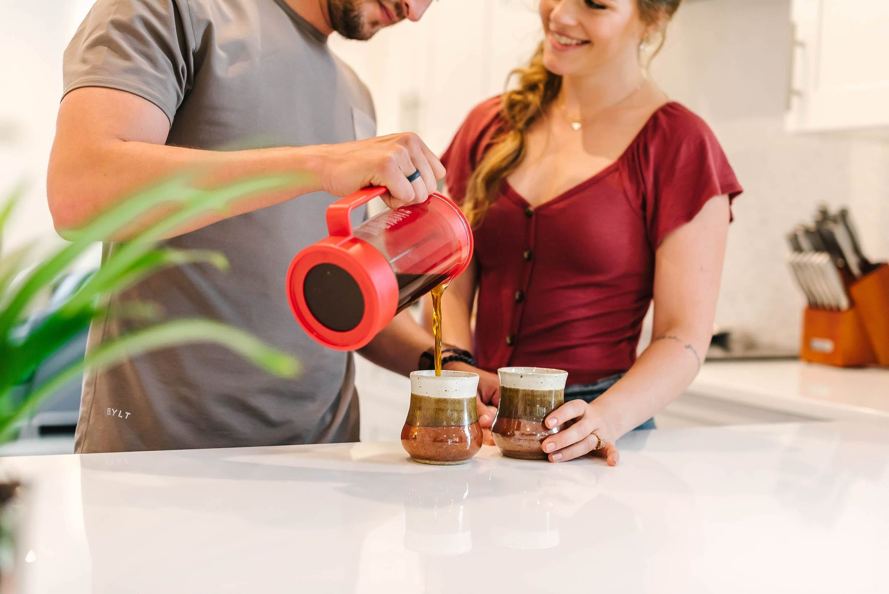 man and woman pouring coffee
