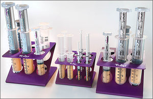 Tulip Z Stand™, Tulip, fat harvesting, syringes sitting in a purple Tulip stand