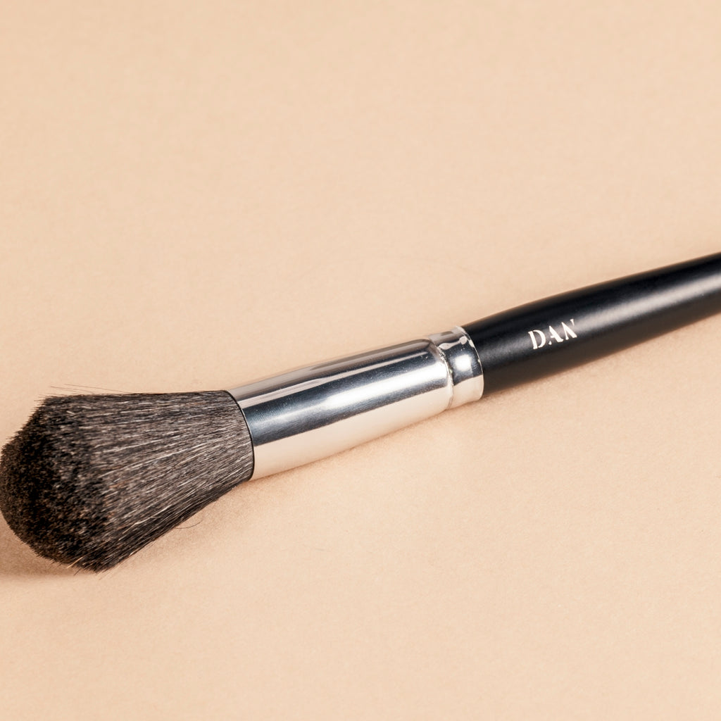 The dome brush is a full, rounded shaped brush with soft fibers.