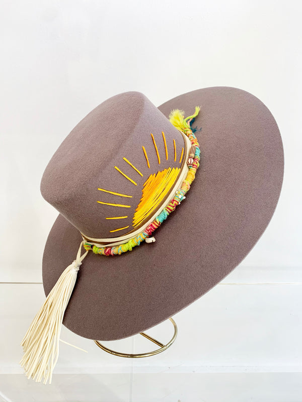 wide brim gray wool felt hat with sun embroidered and a white leather tassel