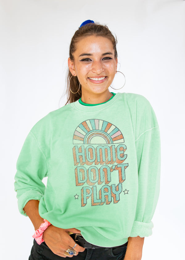 "mint green crewneck sweatshirt with retro rainbow text ""Homie Don't Play"""
