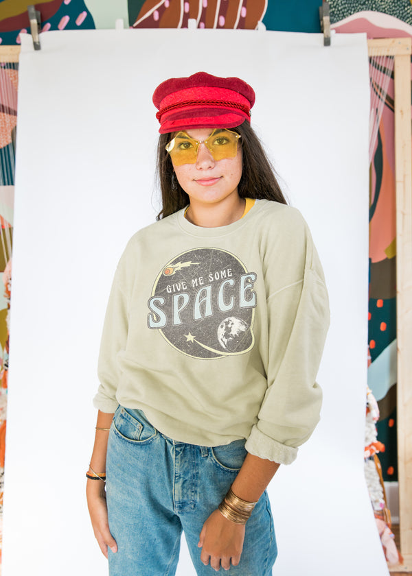 "beige crewneck sweatshirt with circle image of outer space with text ""Give me Some Space"""