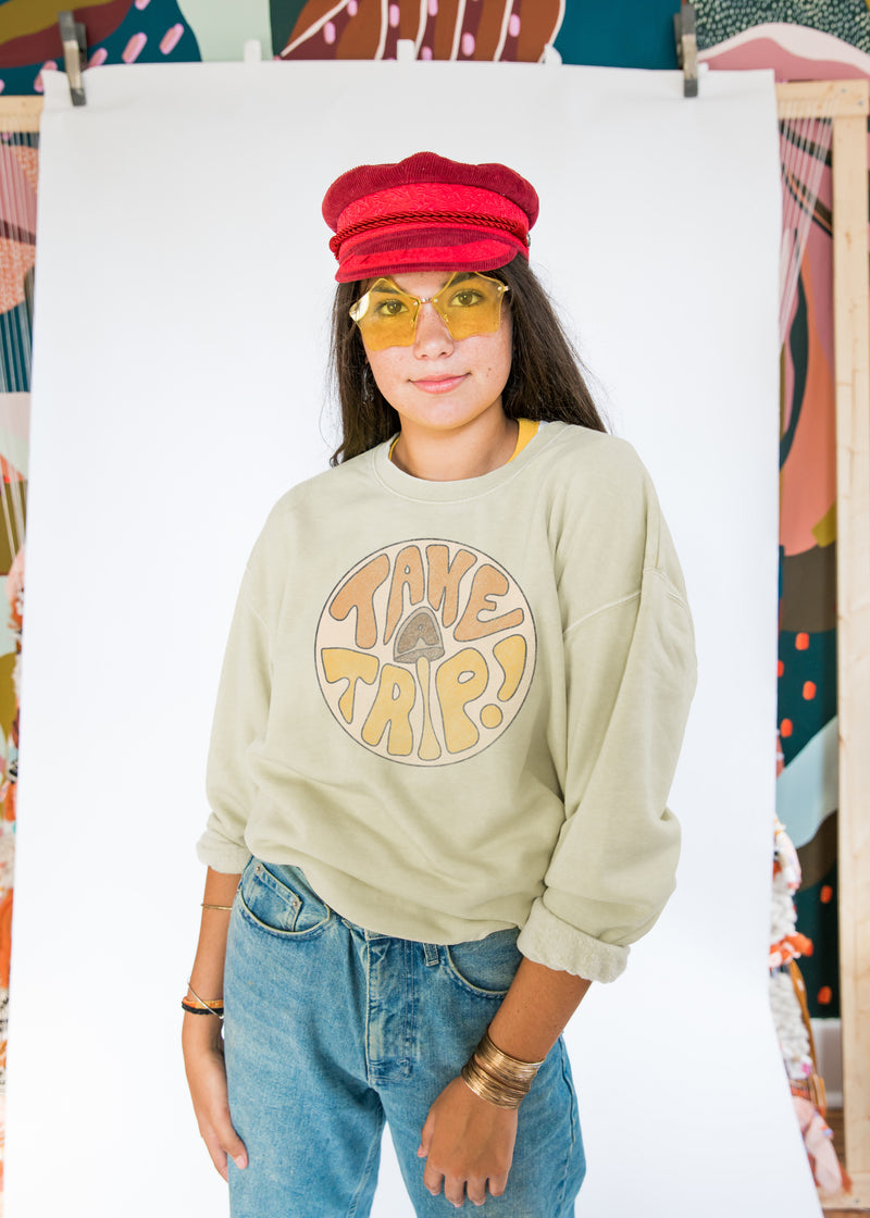 "sage green crew neck sweatshirt with mushroom and 70s text ""Take a trip!"""