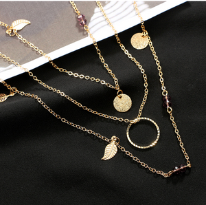 gold and leaf gold necklace layered
