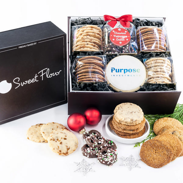 Holiday Bakers Select Gift Box with peppermind chocolate covered pretzels, shortbread and crispy cookies with logo cookie
