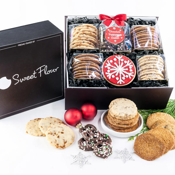 Holiday Bakers Select Gift Box with peppermind chocolate covered pretzels, shortbread and crispy cookies with red snowflake sugar cookie