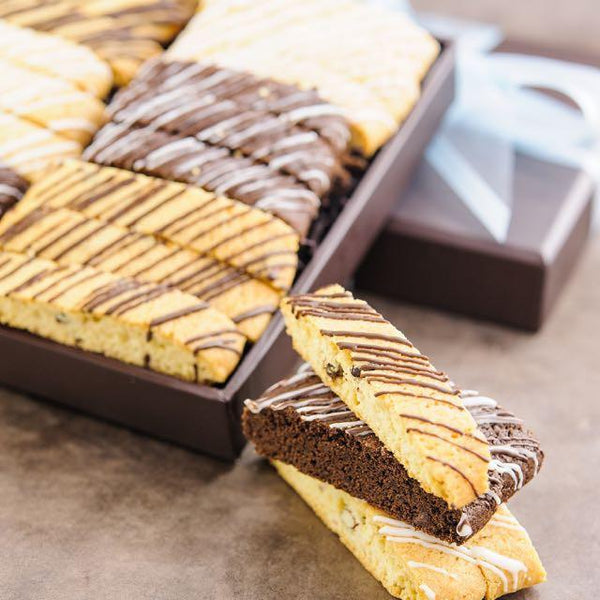 Chocolate Drizzled Biscotti Gift Box with assorted biscotti and blue ribbon