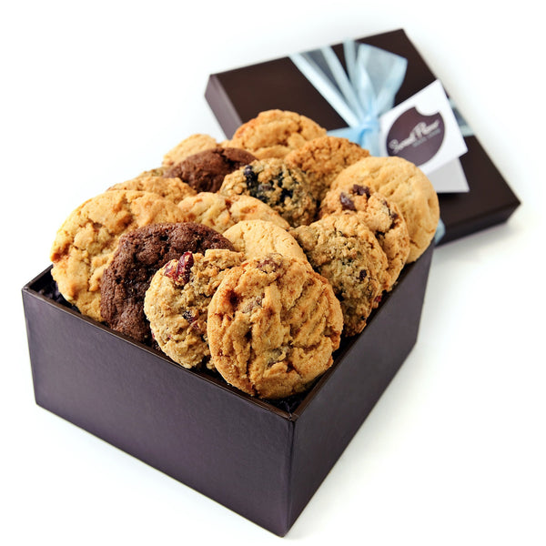 Brown gift box with assorted cookies and blue ribbon
