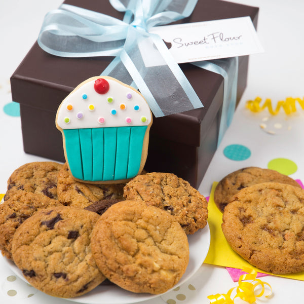 Sweet surpise gift box with assorted cookies and cupcake decorated sugar cookie