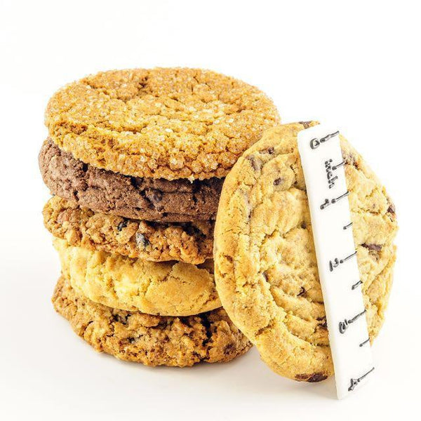 Assorted gourmet cookies stacked on top of another