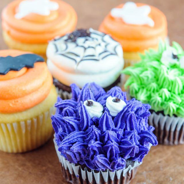 close up of monster and spiderweb Halloween cupcakes