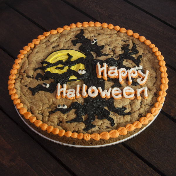 12 inch round Halloween Cookie Cake with spooky tree and moon and orange border icing
