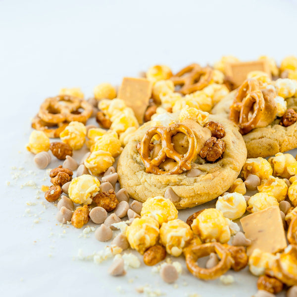 Out of the Park fully loaded stuffed cookie with Gold bar, caramel chips, caramel popcorn, peanuts and pretzels