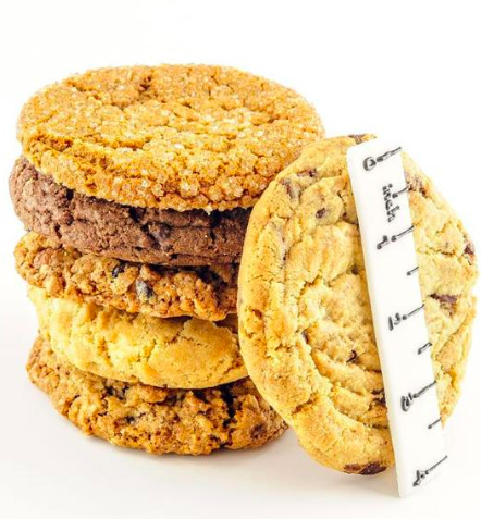 Gourmet cookies stacked on top of another