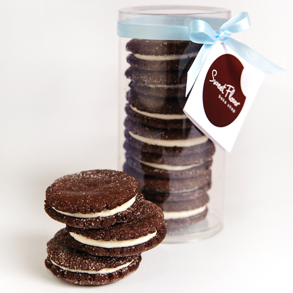Chocolate Sandwich Cookies stacked with 6 packaged chocolate sandwich cookies and blue ribbon