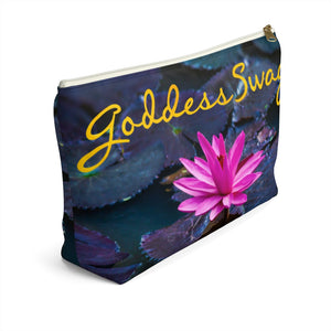 Goddess Swag Bag Mini called Lotus Love.  Bag can be used as an accessory bag, makeup or cosmetic bag.  One side of bag shows a pink lotus with lily pad background and goddess swag writing in gold above the lotus.  The other side of the bag shows the pink lotus and lily pad background only.