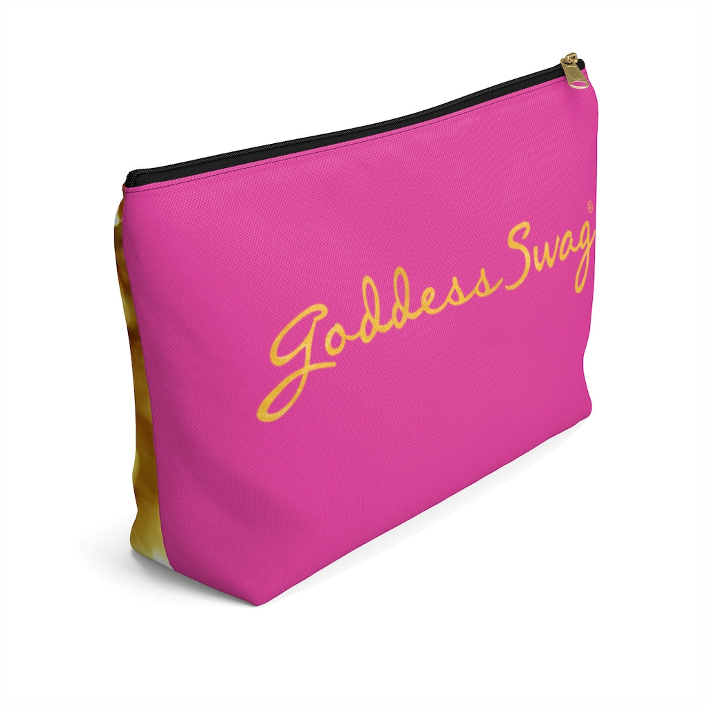 Goddess Swag Bag Mini (named sparkle).  Item can be used as accessory pouch, makeup bag or cosmetic bag. Background is pink on one side with Goddess Swag wording in gold over the pink, and a gold sparkle image on the other side of the bag.  There is an option of a black or a white zipper, and a large or a small bag.