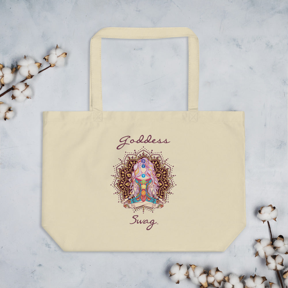 Goddess Swag, Large Eco Tote Bag Organic Cotton Oyster Color with Mandala and Chakra Design by Goddess Swag which is written in deep purple color.