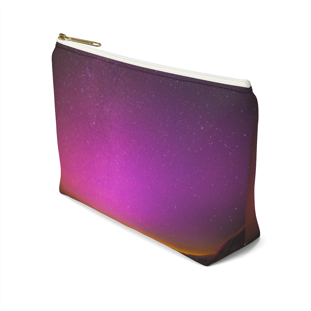 Goddess Swag Bag Mini (named cosmic).  Item can be used as accessory pouch, makeup bag or cosmetic bag with a background is purple with some orange like sunset.  Goddess Swag wording is in gold on one side of the bag only.  There is an option of a black or a white zipper, and a large or a small bag.