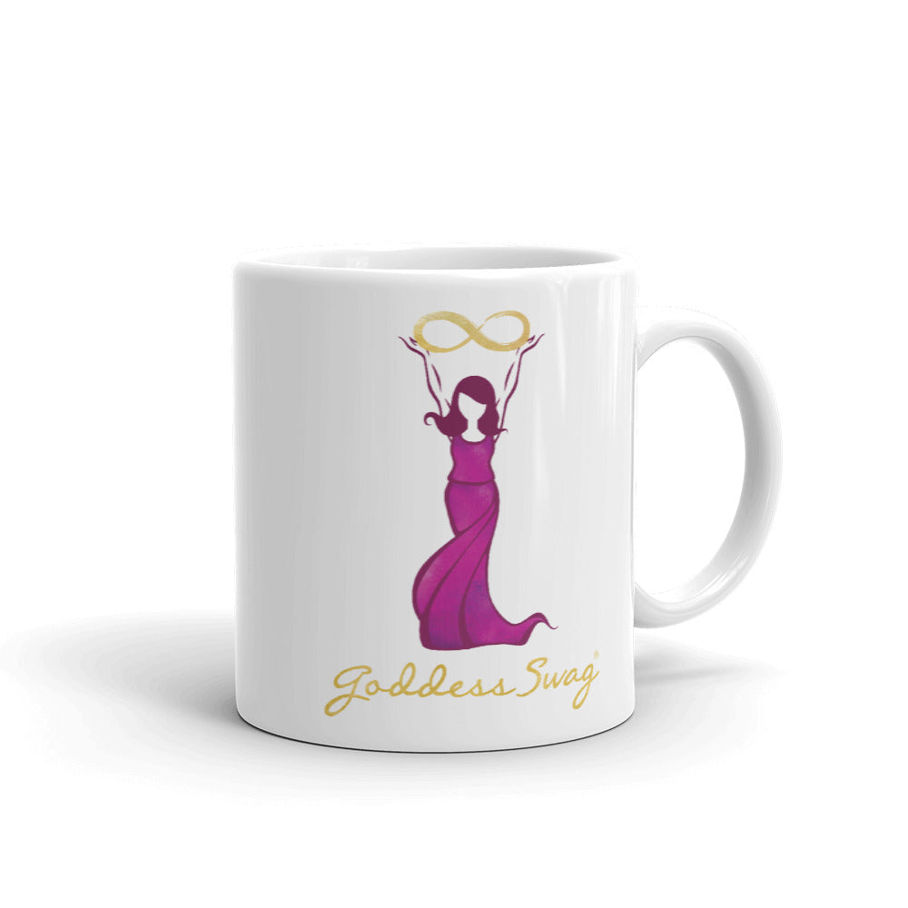 Goddess Swag Signature Logo Ceramic Coffee Mug 11oz with goddess holding  a gold infinity design above her head.  Her dress is magenta.  Goddess Swag is written in gold.