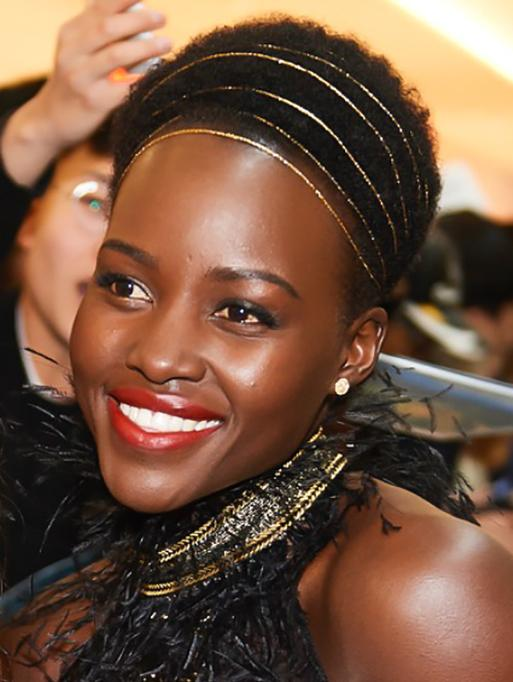 Lupita Nyong'o wearing the Diamond Disc Studs