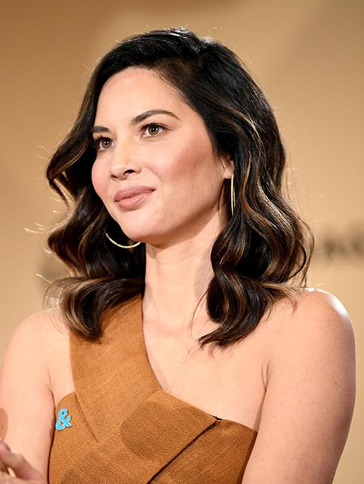Olivia Munn wearing the Twisted Hoops