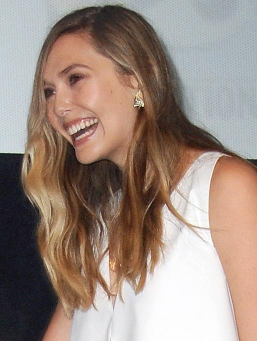 Elizabeth Olsen wearing the Linked Marquis Diamond Band