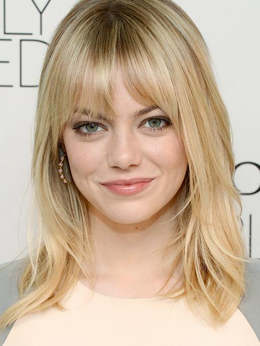 Emma Stone wearing the Woven Marquis Stone Hoops