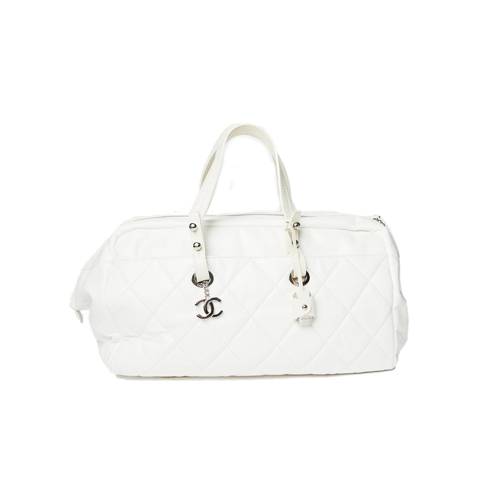 CHANEL jumbo white leather quilted travel bag
