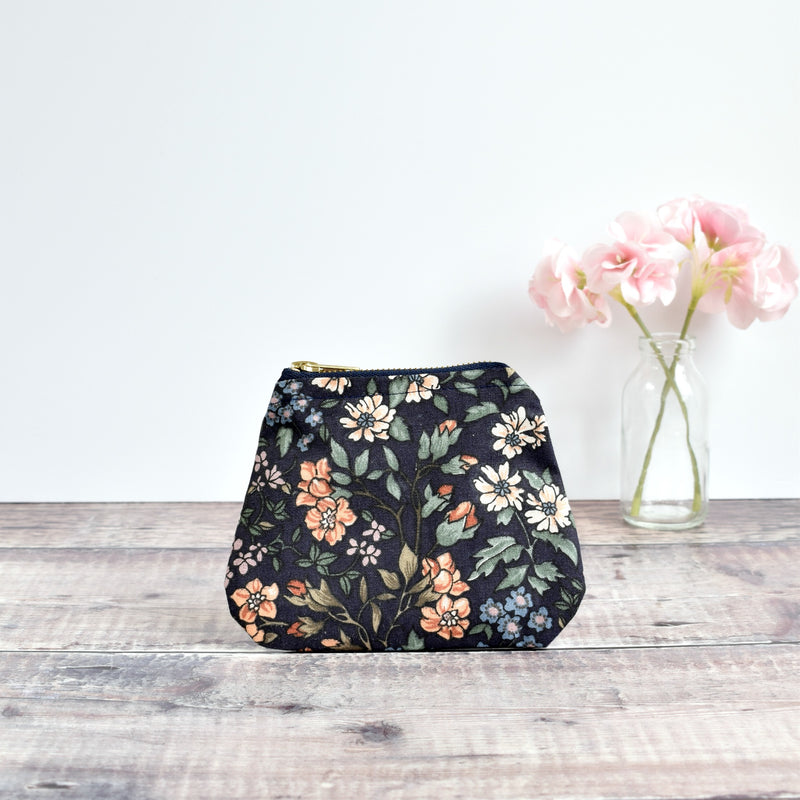 Coin purse made from dark blue vintage floral fabric handmade by Stitch Galore