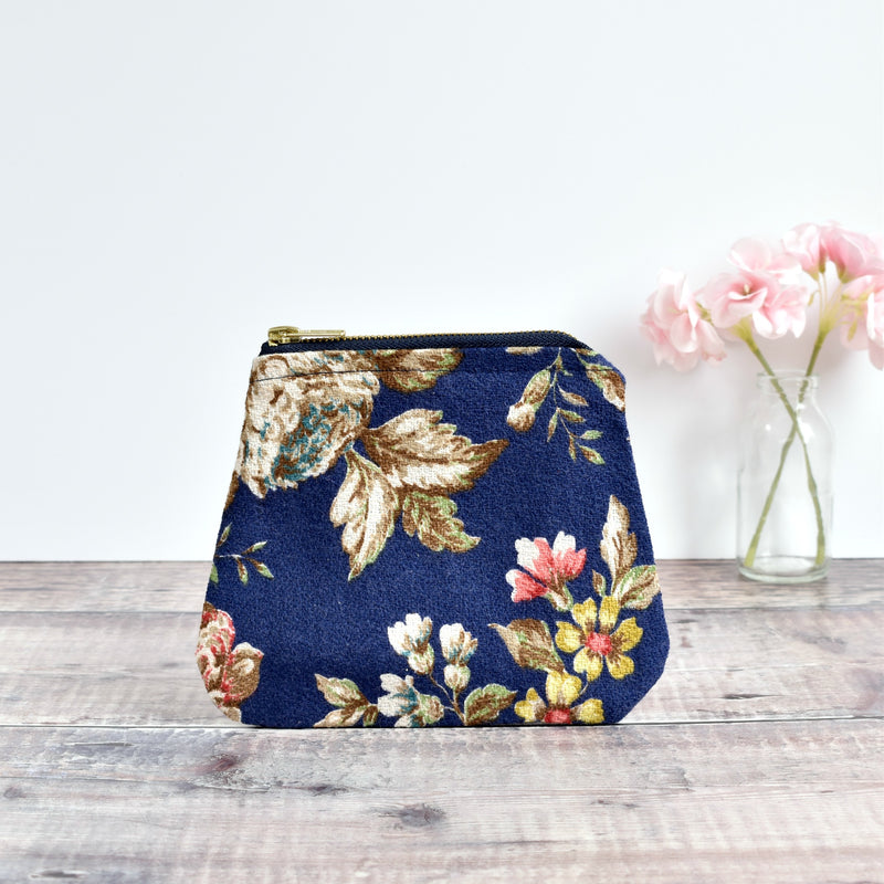 Zip purse, makeup bag made from blue barkcloth vintage floral fabric handmade by Stitch Galore
